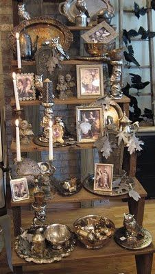 spooky portraits, silverplate, statues display