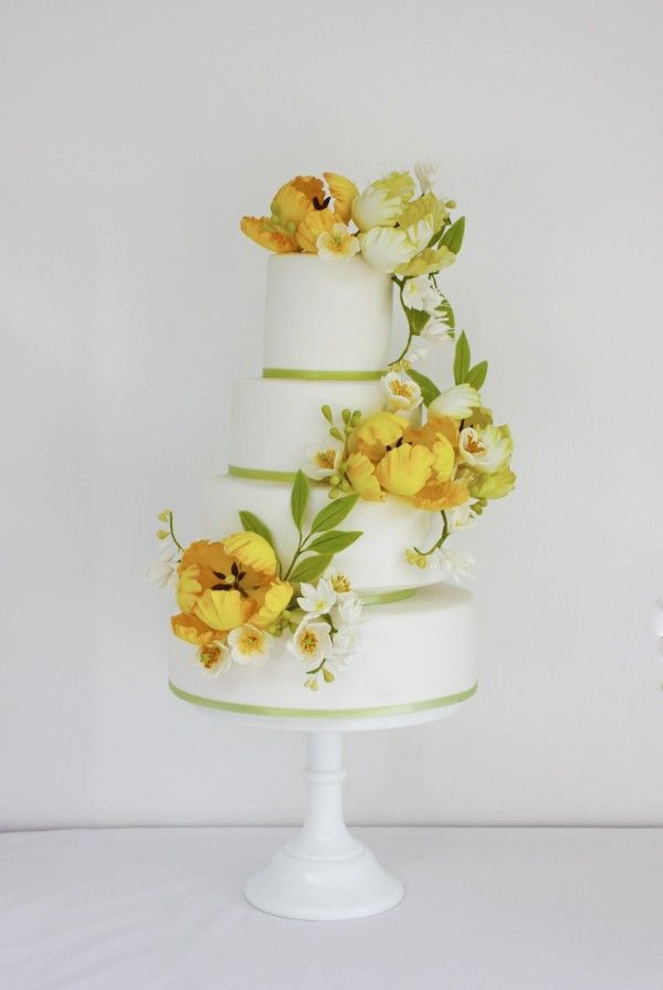 tiered wedding cake with yellow sugar flowers sugar parrot tulips sugar freesias victoria's cake company market harborough leicestershire