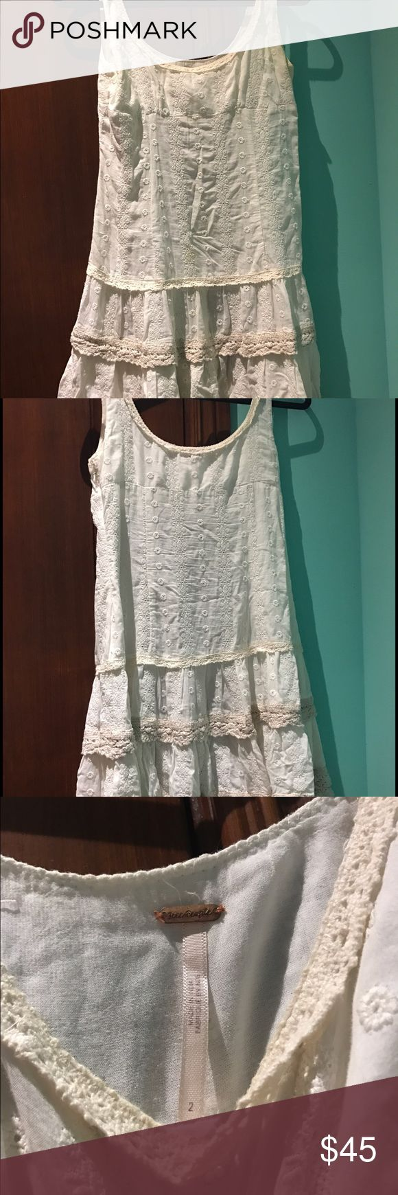 FREE PEOPLE white dress w/ cream and tan trim white/cream dress with lacey trim, super cute for summer or spring. a little see through w/ flowery holes perfect to wear a slip under or just to wear to the beach. Free People Dresses Mini
