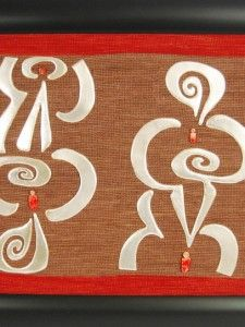 Made by Olga Serrano, inspired by Pre-columbian stamps, this hanging art was woven by hand in an burlap, using silver metal and Spondylus stone.  Dimensions: 22.52 inches x 30.52 inches (57.2 cm. x 77.52 cm.)  www.gogoanhalzer.com