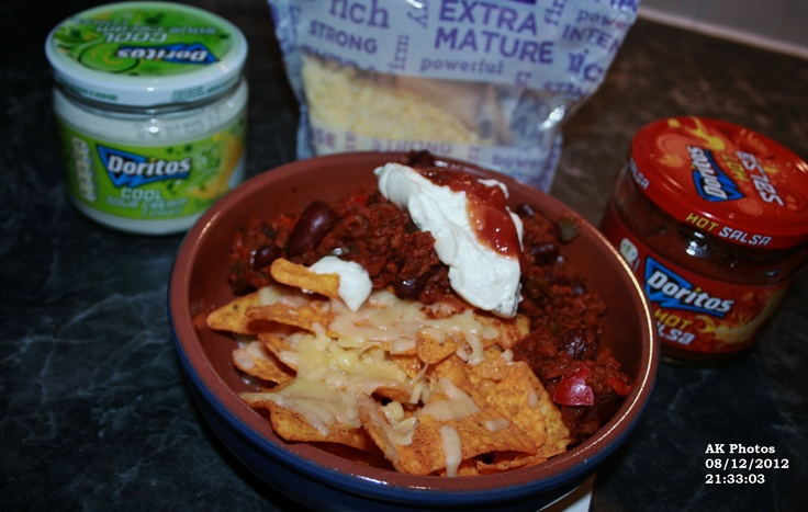 chilli and nachos with cheese and hot salsa