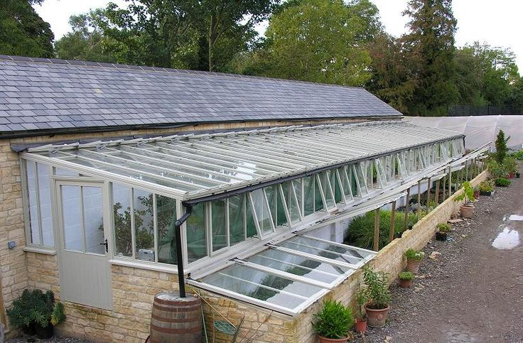 I LOVE these cold frames against the lean to greenhouse