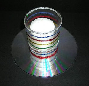 This is a guide about making a CD candle holder. The reflective nature of CDs make them a good choice to include in a homemade candle holder.
