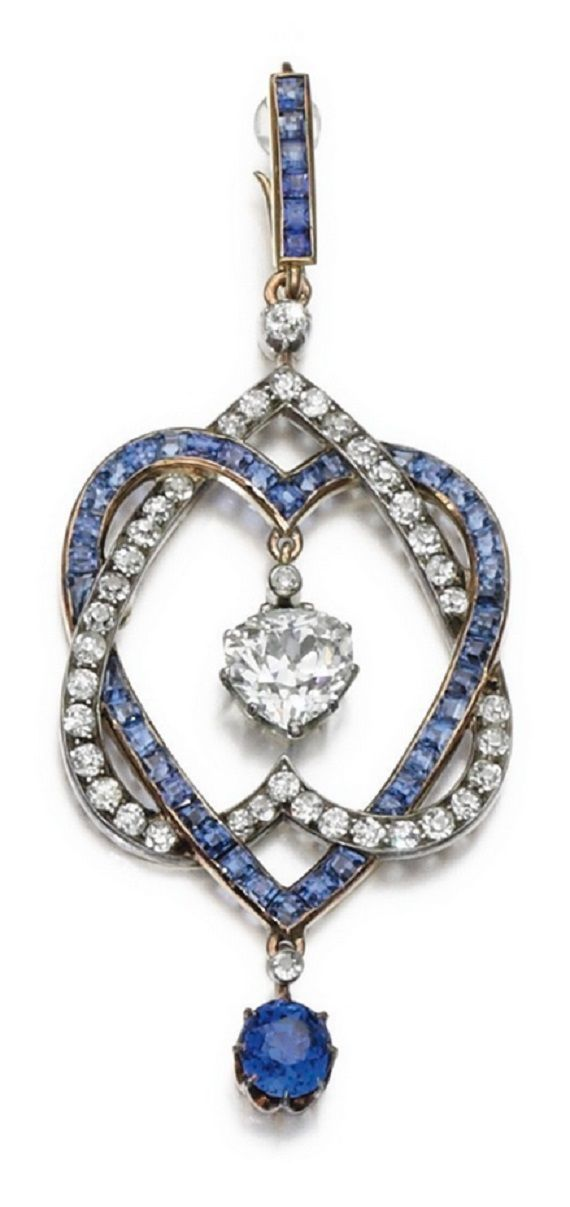 An antique sapphire and diamond pendant, early 20th century. Composed of two interlocking hearts set with calibré-cut sapphires and circular-cut diamonds respectively, suspending a pear-shaped diamond and an oval sapphire, to a belcher link chain, length approximately 460mm. antique
