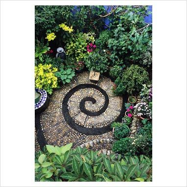 GAP Photos - Garden & Plant Picture Library - Small patio with spiral design made form cobbles and slate - GAP Photos - Specialising in horticultural photography