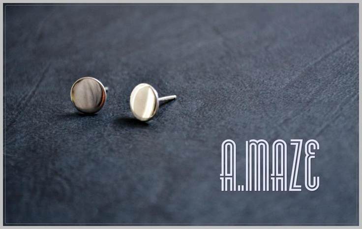 Sterling silver dot stud earrings with a mirror effect.