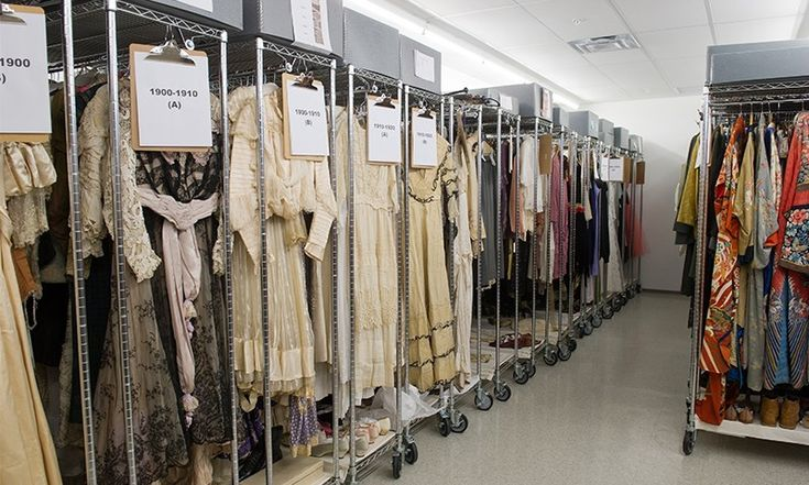 Syracuse University costume storage. Rolling garment racks, with shelving above (hats/accessories) and below (shoes). Genius space-saver.