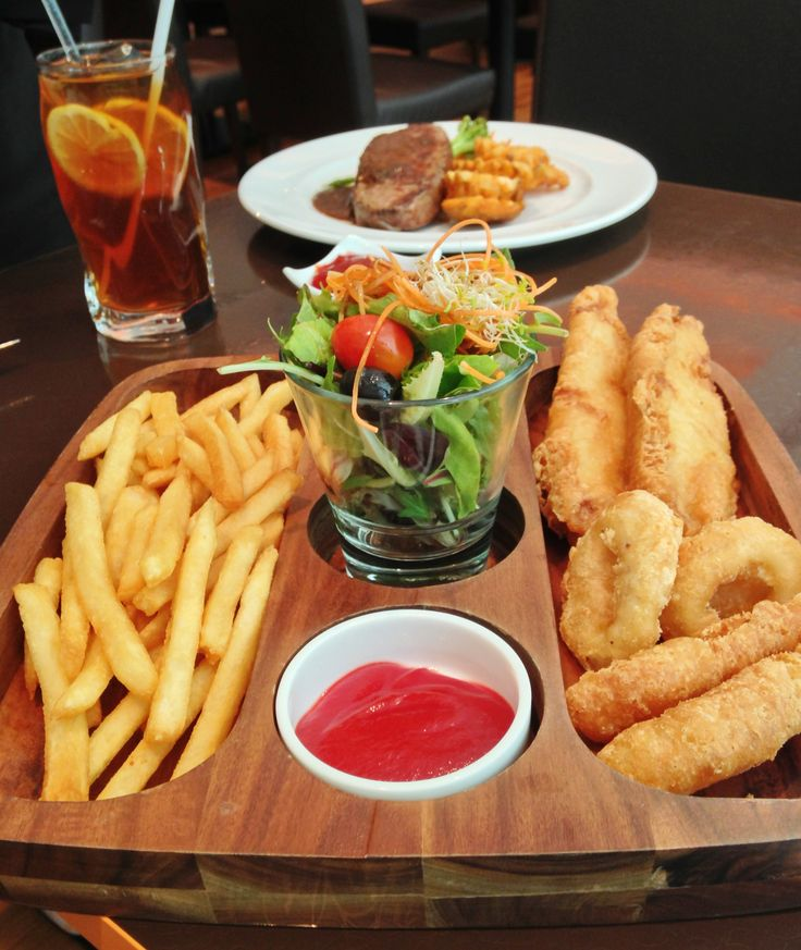 Seafood platter with fish & chips, calamari & tempura with condiments on the side. Simply irresistible at Cafe 2000, M Hotel Singapore.