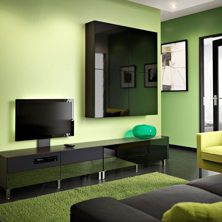 "BESTÅ/UPPLEVA black-brown TV bench and wall cabinet with black high-gloss drawer fronts and doors including 32"" LED TV"