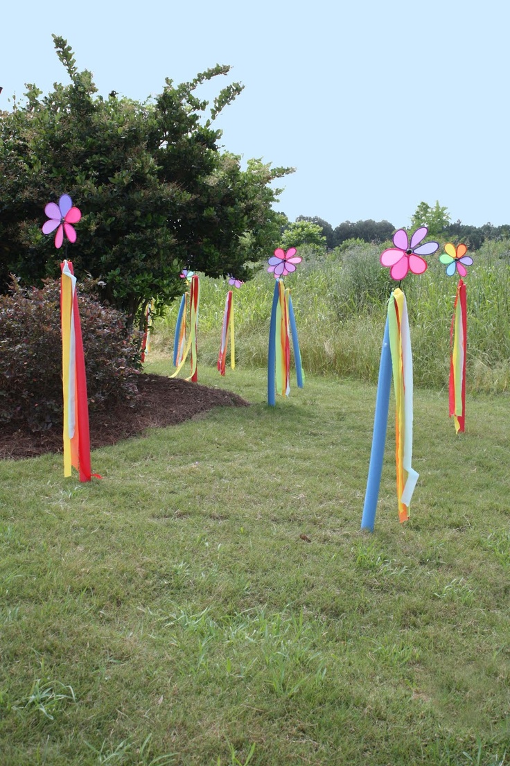 water noodle and dollar tree pinwheel  with streamers for a birthday party entrance....too cute!