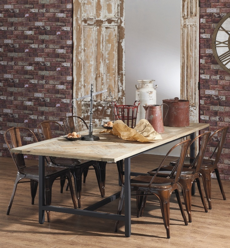 Industrial style dining table with recycled timber parquet top and metal base from Domayne