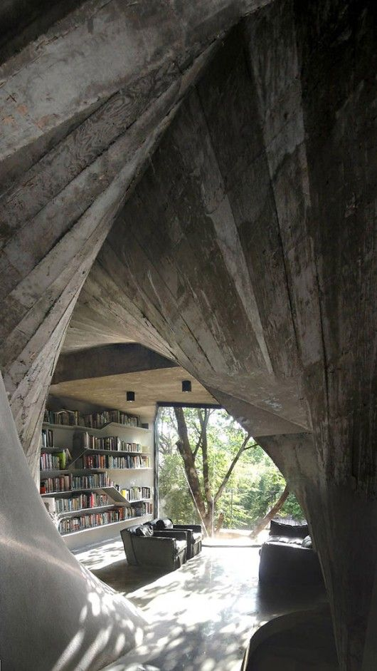 Concrete walls twist up through the interior of this tea house and library that Shanghai architects Archi-Union have constructed in the backyard of their studio.