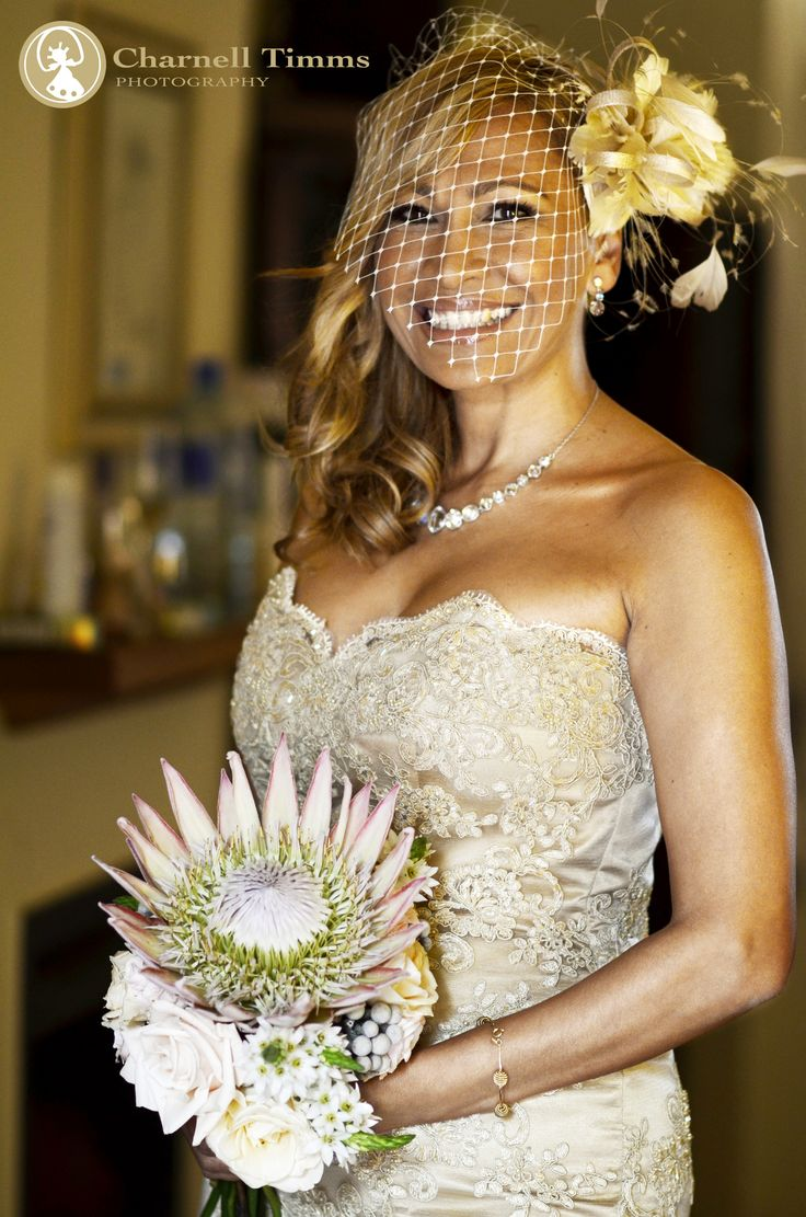 Neisha and her bridal bouquet. Charnell Timms Photography