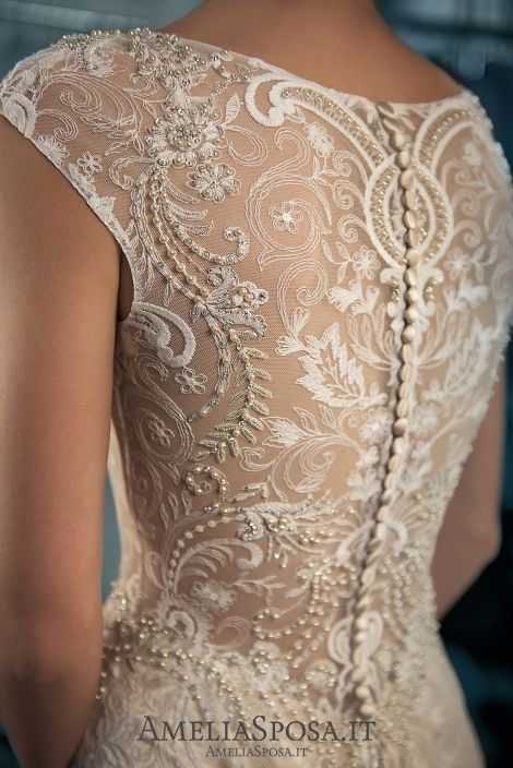 Wedding dress Adele - AmeliaSposa. This dress in front of you is a genuine masterpiece. Elegant shape and pure lines draw your attention to the beauty of lace that creates an aristocratic look. Pearls, beads and Swarovski crystals put a right accent on the dignity of the occasion.