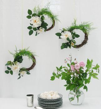 The perfect decoration for a Summer country wedding, this pretty hanging wreath is adorned with beautiful faux cream garden roses and asparagus ferns. Everything at Just Add a Dress is designed for brides looking for DIY wedding decorations that are as stylish as they are easy to install. Ideal for a pretty rustic wedding, this gorgeous twig wreath is dressed with super realistic cream garden roses and 2 tone asparagus fern fronds.