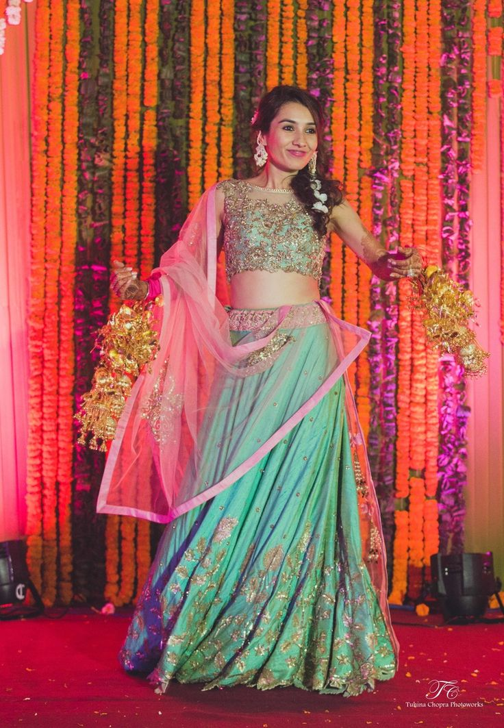 Turquoise silk lehenga by Anushree Reddy