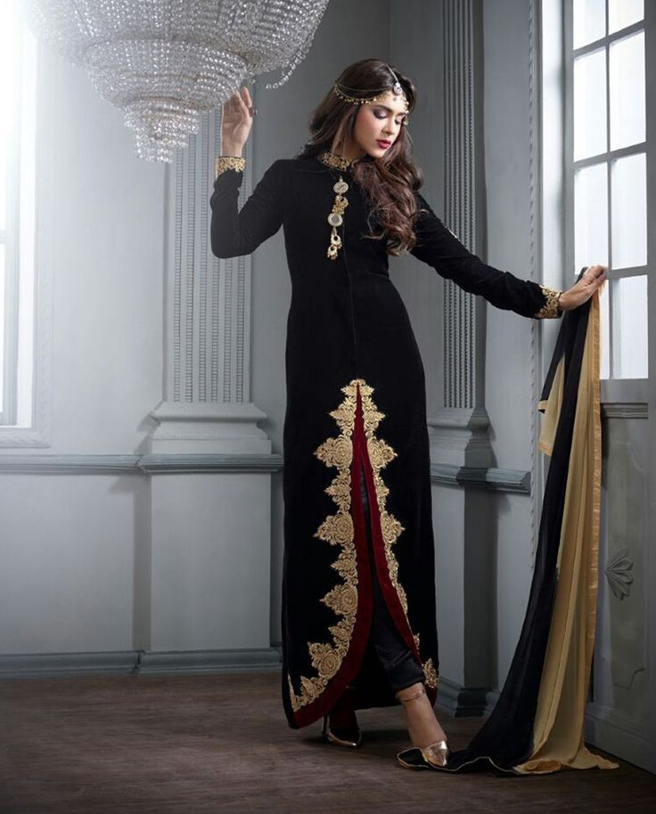 Black front slit suit with embellished hemline   1. Black velvet front slit embroidered suit2. Golden zari embroidery on hemline3. Comes with matching santoon bottom and chiffon dupatta4. Can be stitched upto size 42 inches