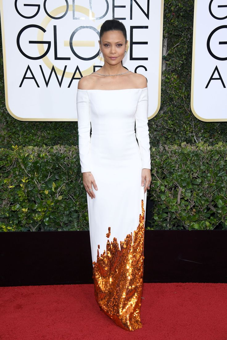 Chokers! Off-the-Shoulder Dresses! It's 2016 All Over Again At The Golden Globes Red Carpet #refinery29  http://www.refinery29.com/2017/01/135216/golden-globes-2017-red-carpet-fashion#slide-11  This white number on Thandie Newton looks like it was dipped in gold and sent straight to the red carpet. But in reality, we can only imagine how many hands it took to sew every sequin. Nice work, team Monse....