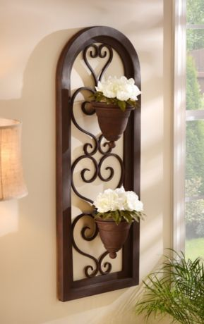 Indoors or outdoors, this scrolled metal wall planter adds a beautiful touch to your decor. The planter features two metal pots for flowers and other plants. #kirklands #lifeonthelanai #wallplanter