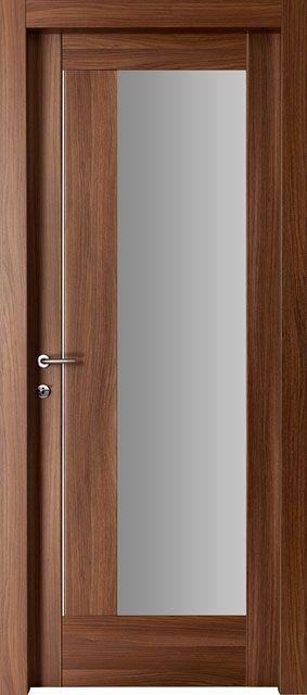 L'incavo del #legno lascia la sua impronta decisa ed #elegante al tempo stesso. L'alternanza delle venature esalta il #gioco del #colore. #porta #interna modello Therese, codice 1Z.1I.1V. Colore Noce Canaletto. Catalogo Ensemble.