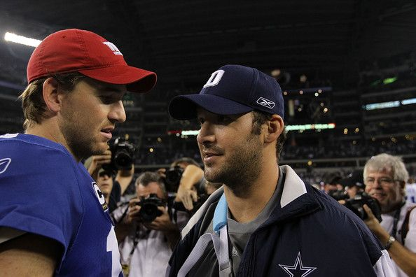 Tony Romo Photos Photos - Quarterback Tony Romo #9 of the Dallas Cowboys talks with Eli Manning #10 of the New York Giants after a game at Cowboys Stadium on October 25, 2010 in Arlington, Texas. - New York Giants v Dallas Cowboys