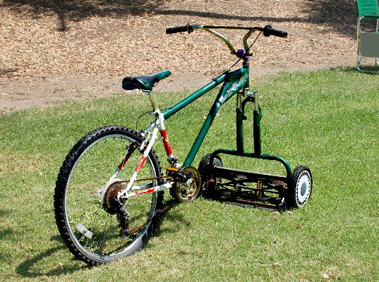 This ingenious bicycle-lawnmower fashioned by an unknown suburban lawn owner out of an old bicycle and a broken lawnmower, is a testament to the creativity of the human spirit.