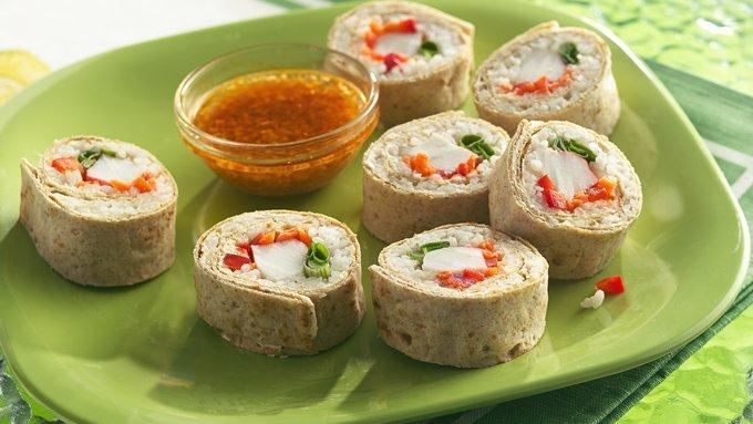 Skip the seaweed! Wrap sushi ingredients in whole wheat wrappers, then dip in a spicy sauce.