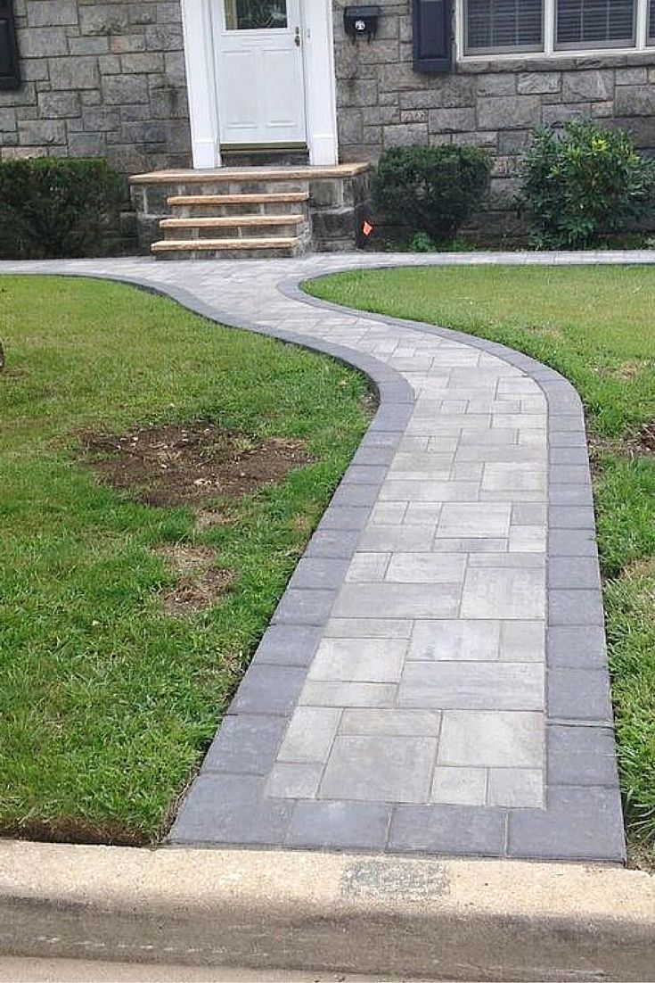 This is a beautiful walkway curb to door! This walkway was installed by Fine Design Landscaping using Cambridge Pavingstones.