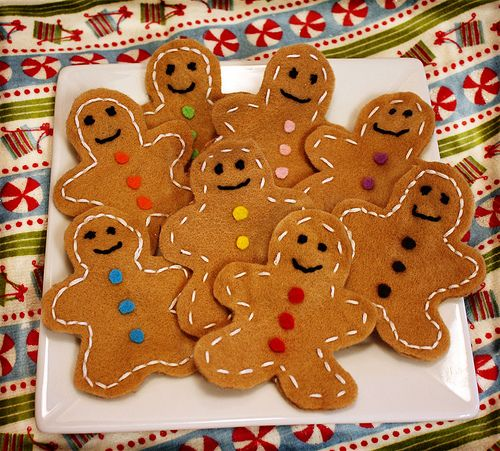 Gingerbread Felt- I'd turn this into a Christmas project for kids, letting them put facial features, buttons, etc. on their felt gingerbread people