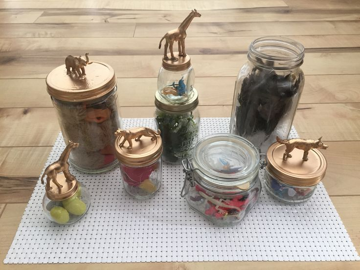 DIY Snape's office:  jars from the house filled with toy eggs, rubber snakes, plastic insects, feathers, stuffed animals, etc.