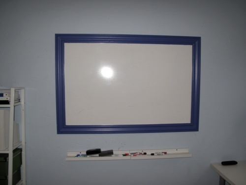 Marker Board - out of shower stall material, also called melamine - this is what dry erase / marker boards are made of....super cheap and customizable