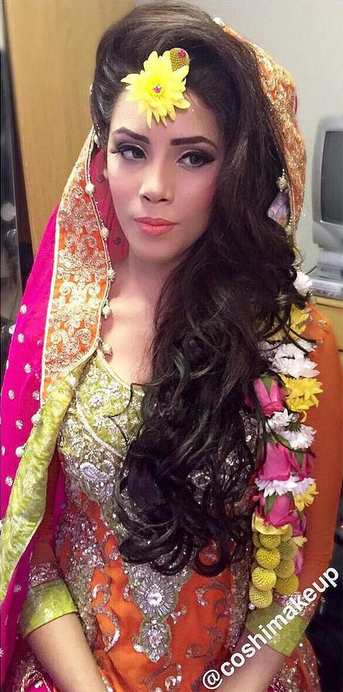 Colorful Mehndi Bride with Flowers in Her Hair