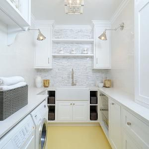 Luxe Design Build - laundry/mud rooms - white and yellow laundry rooms, long laundry room, flush mount, laundry room lighting, laundry room flush mount, laundry room cabinets, crisp white cabinets, white quartz countertops, laundry room shelves, laundry room shelving, shelf over sink, over the sink shelf, laundry room floating shelf, laundry room floating shelves, farmhouse sink, laundry room sink, gooseneck faucet, laundry room cubbies, laundry room bins, pull out bins, cabinet over washer…