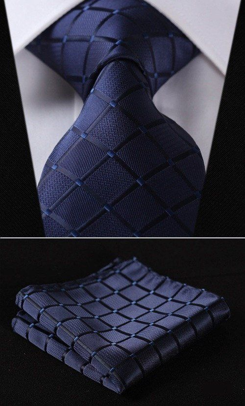 "This is a sleek blue design that sets it off perfectly! Handmade from 100% silk. The tie measures 2.75"" at its widest point. - Includes: Tie and Handkerchief - 100% SILK - Dry Clean Only"