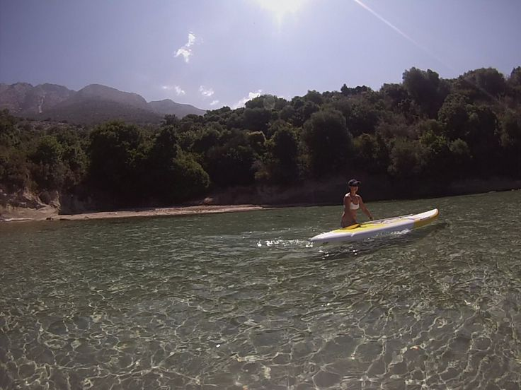 Discovering the local coastline, SUP board cruising.