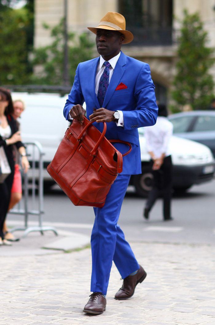Suit:  Blue Suit with Blue/Paisley Tie and Red Pocket Square  Bag:  Red Leather Tote  Photo By: Phil Oh