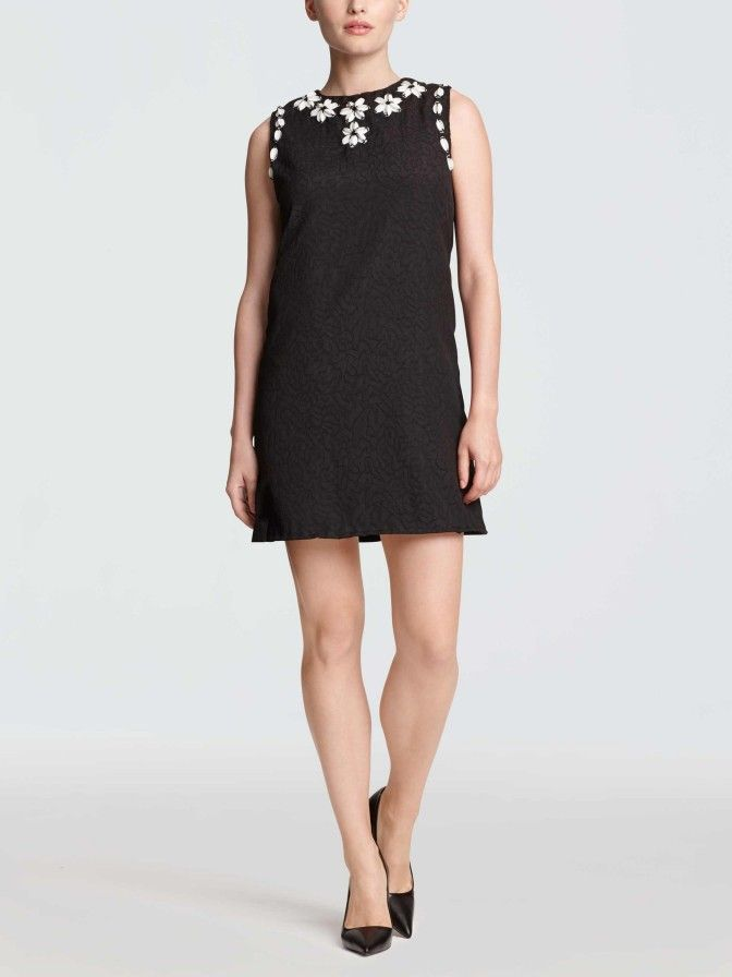 We started with a flattering black a-line shift in a stretch cloque (a raised woven fabric with a textured effect) and then amped it up with beautiful hand-embellished sequin and beaded daisies along the neck and narrow armholes. Paired with classic black heels, our Collection Embellished Shift Dress is a polished look with just the right amount of fancy.