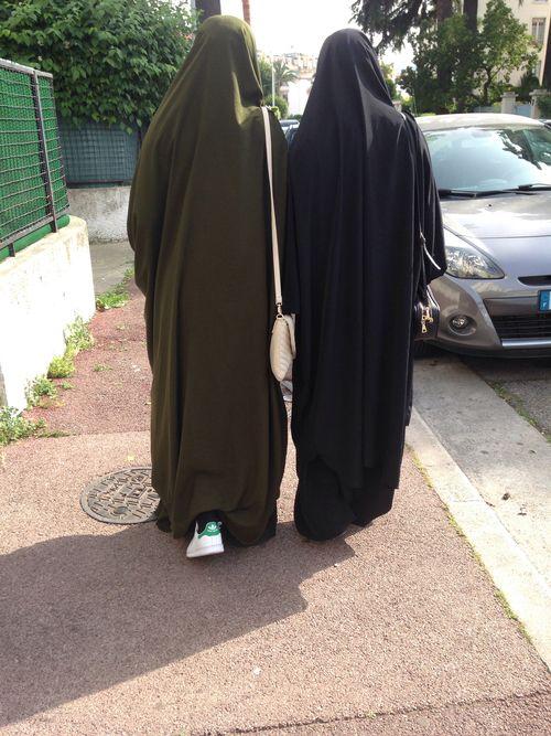 Two Sisters Walking