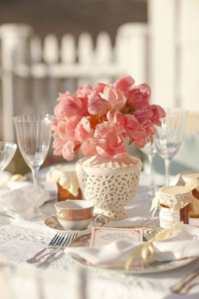 coral blooms and a white vase/table...such a fresh, pretty look.