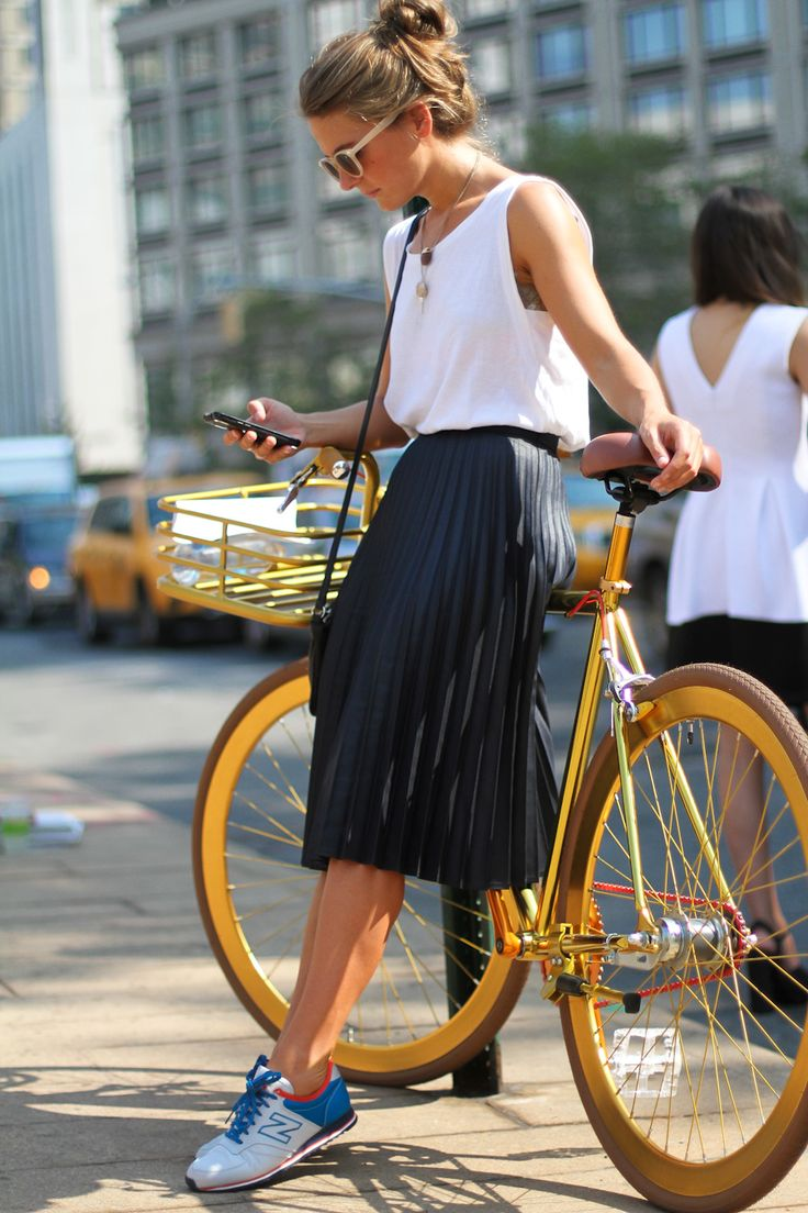New York fashion week pleated skirt + sneakers