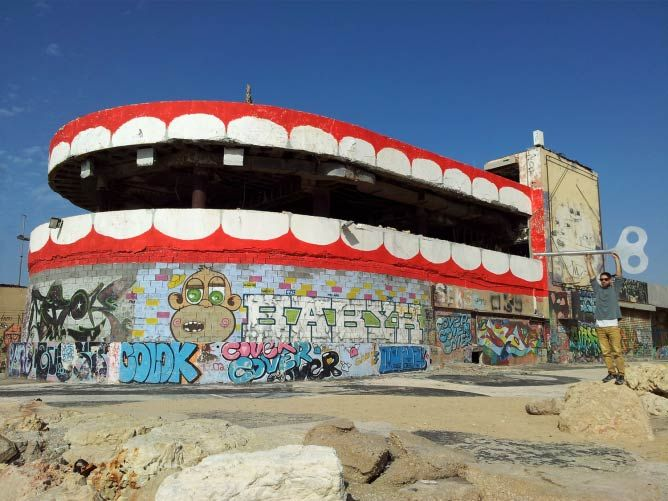 The Top 5 Street Artists in South Tel Aviv. Who's your favorite? In the pic: Dede's dental work on Tel Aviv's iconic Dolphinarium. http://restreet.altervista.org/la-street-art-dell-israeliano-dede/