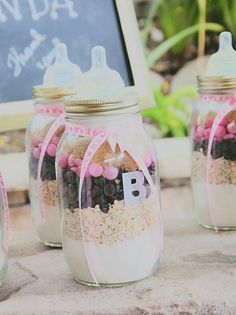 I love  they made these DIY mason jar favors look like baby bottle!  Perfect baby shower favors.  Make your own cookies kit.