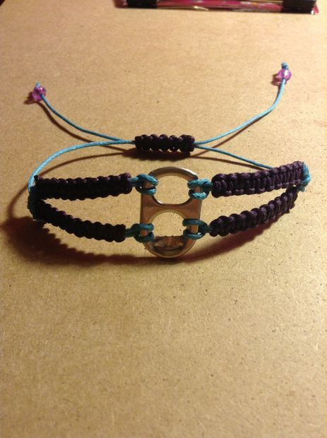 Never know what to do with that soda can after it's empty? Take off the tab and make this cute bracelet!