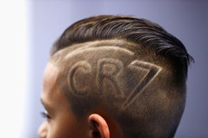 An escort kid with his new CR7 haircut.