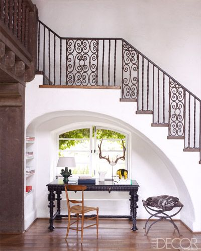 An alcove in the living room of Reese Witherspoon's Ojai home contains a mahogany desk, a 1920s Swedish chair, and a 19th-century Spanish stool topped with an Indian blanket.