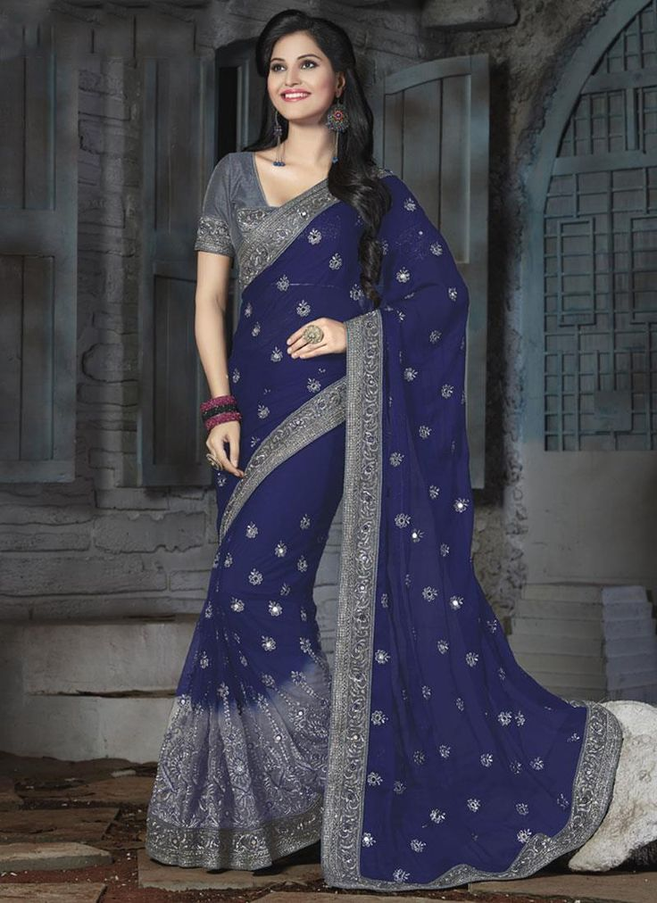 Online saree shopping from an exclusive collection of designer sarees. Buy this faux chiffon and net embroidered and patch border work classic designer saree for party and wedding.