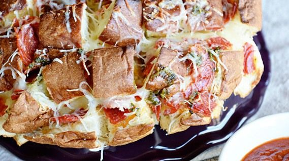 Pepperoni Pizza King's Hawaiian Bread...sweet Hawaiian bread topped with mozzarella cheese and pepperoni and served with warm marina sauce