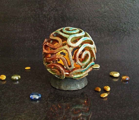 Hey, I found this really awesome Etsy listing at https://www.etsy.com/listing/207716455/raku-pottery-candle-holder-tealight