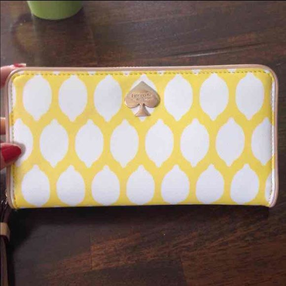 KATE SPADE WALLET Second picture shows minor wear on metal! Was used for a week! Like new. Retails $178 LIMITED EDITION LEMONS kate spade Bags Wallets