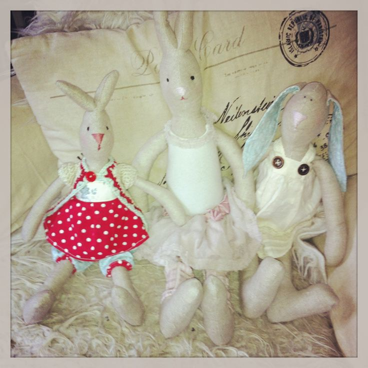 A combo of hand sewn bunnies with some crocheted clothes!